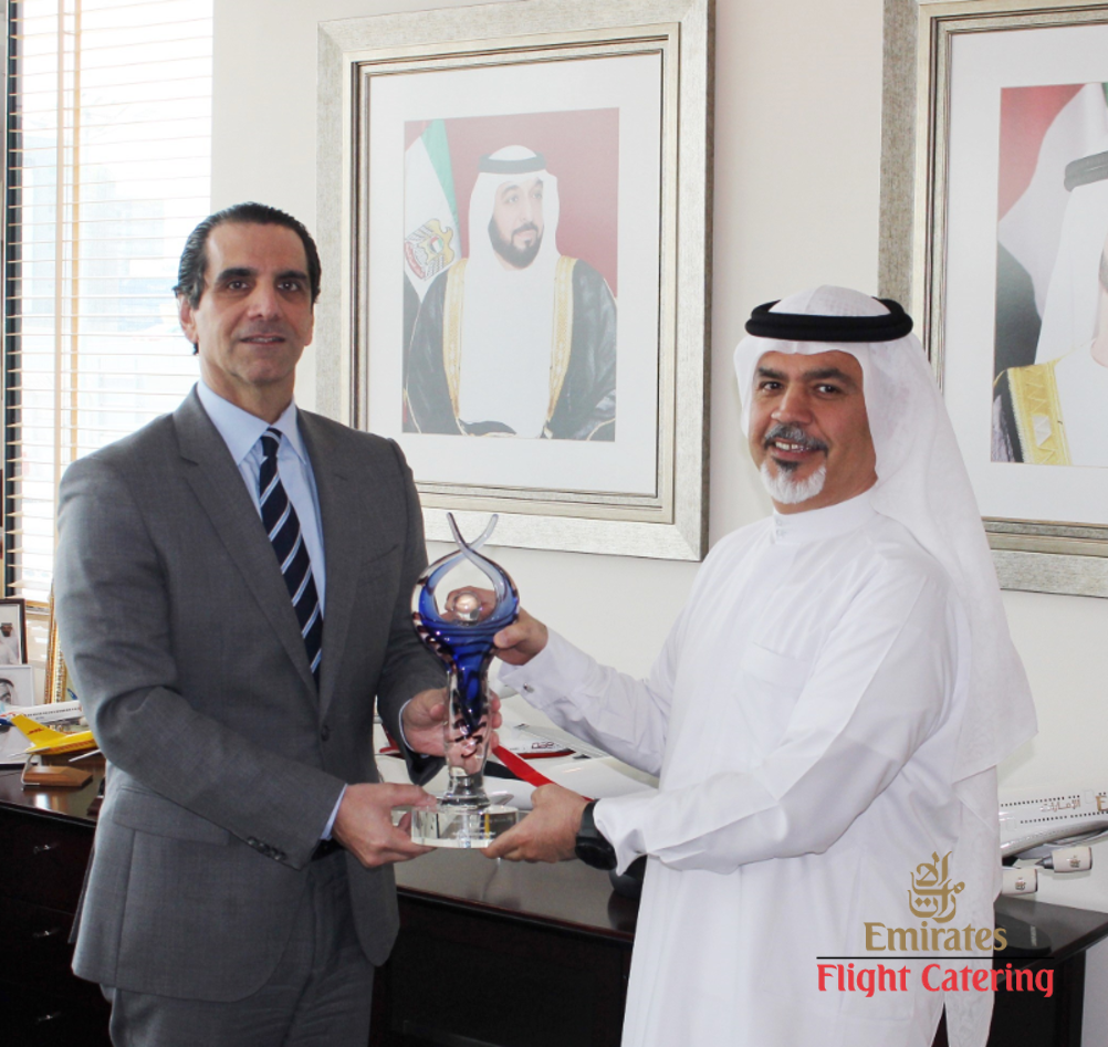 COO Faysal Moufarrej & CEO Saeed Mohammed displaying award